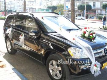 wedding car with roses